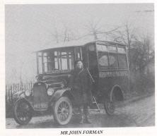 John Forman next to his car